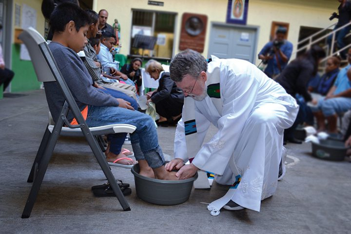 Fr. Pat Murphy washes the feet of a Latin-American boy on Holy Thursday.